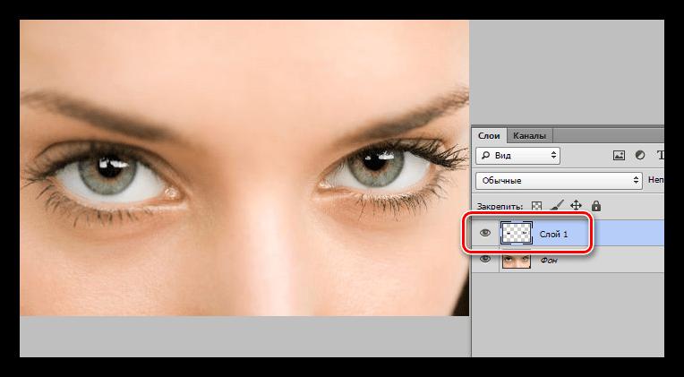 Отделение участка от основного слоя при выделении глаз в Фотошопе