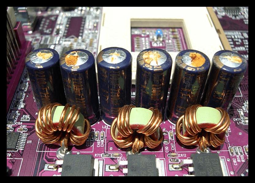Вздувшиеся конденсаторы на материнской плате компьютера