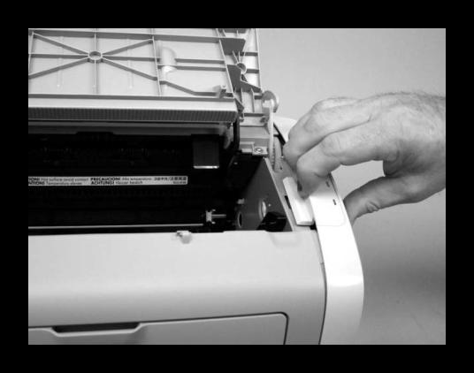 Снятие боковой крышки принтера Canon при уверенностью  его разборке